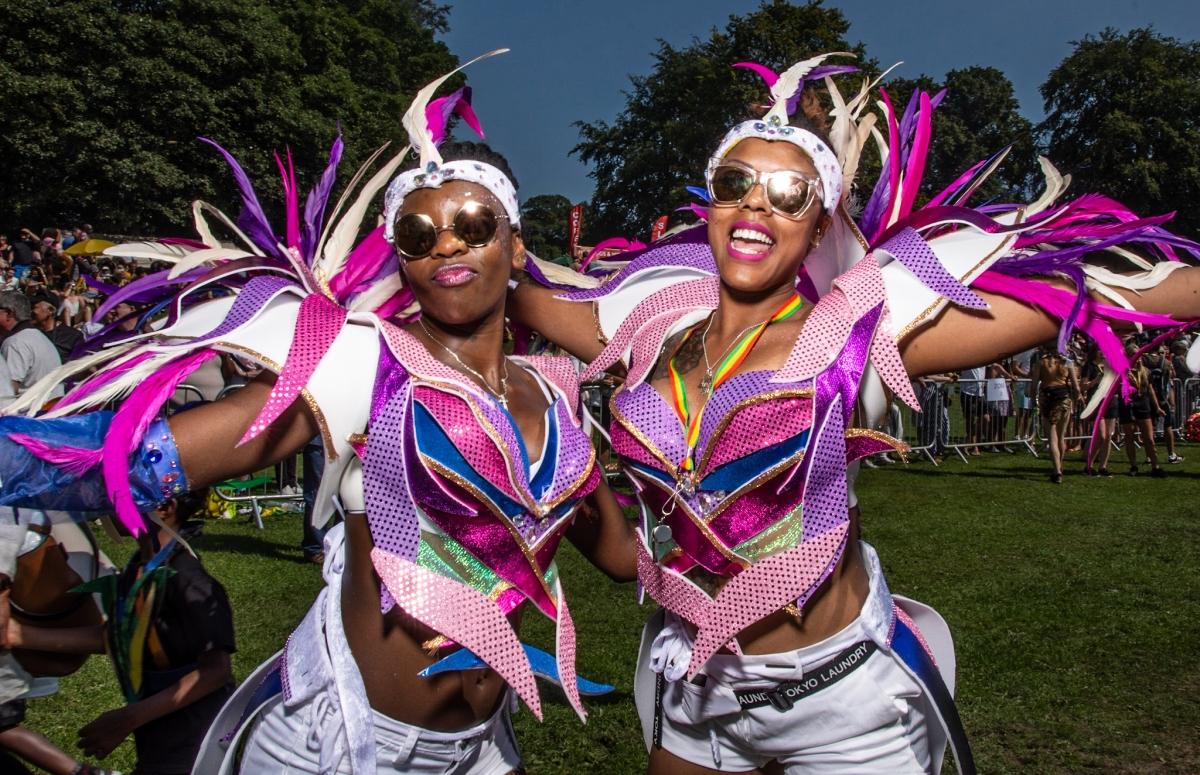 two Caribbean women in Carnival costume