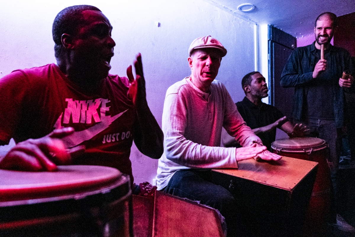 musicians on drums and singing